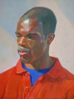 Gbenga Ilumoka Wearing a Red Top