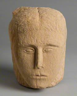 Sandstone Head with Carved Face