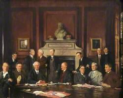 Group Portrait, Top Row: D. L. Keir, W. A. Walker, A. D. Gardner, G. D. H. Cole, J. C. R. Maud, A. L. Goodhart, J. H. S. Wild, Bottom Row: E. J. Bowen, A. B. Poynton, Sir Michael Sadler (Master), A. S. L. Farquharson, E. F. Caritt, G. H. Stevenson, K. K. M. Leys