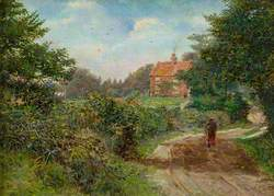 Man in a Lane Approaching a House