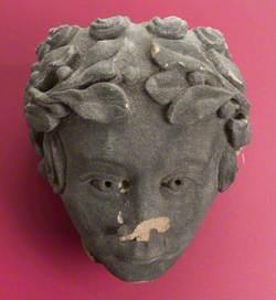 Stone Head with Laurel Wreath