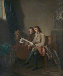 A Man and a Boy Looking at Prints