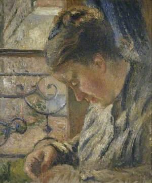 Mme Pissarro sewing beside a Window