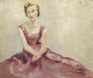 Portrait of a Young Woman with Blonde Hair in a Pink 1950s-Style Dress