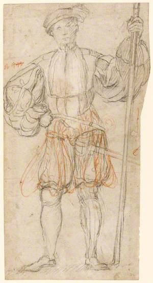 Man Standing Holding a Staff
