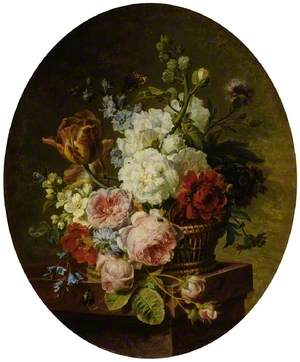 Open wicker basket of mixed flowers, including tulip, roses, harebell, hollyhock, poppy, larkspur and auricula on a marble ledge