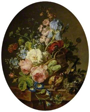 Open wicker basket of mixed flowers, including iris, roses, poppies, hollyhock, marigold, larkspur and convolvulus on a marble ledge with an open pomegranate and a goldfinch with its nest