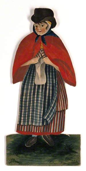 A Country Woman Wearing Hat and Red Cloak