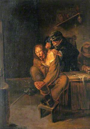 A Surgeon Operating on a Man's Shoulder