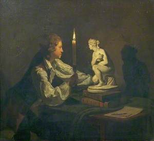 A Boy Admiring a Statuette by Candlelight
