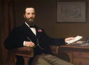 John J. Norton Holding a Letter