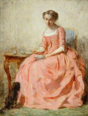 Girl in a Pink Dress Sitting at a Table with a Dog