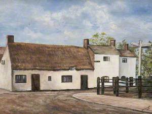 White Building with Thatched Roof
