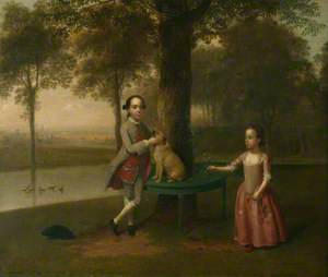 Two Children and a Dog in a Park