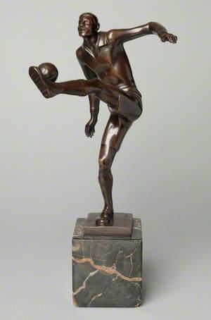 Footballer Kicking a Ball*