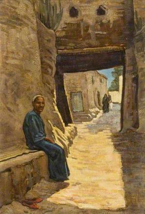 A Man Seated in an Egyptian Village Street