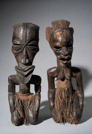 Pair of Traditional Sculptures of a Male and Female