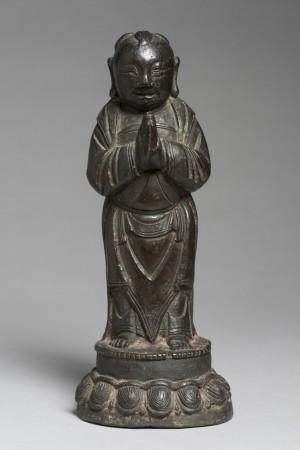 Buddhist Monk with Hands in Prayer