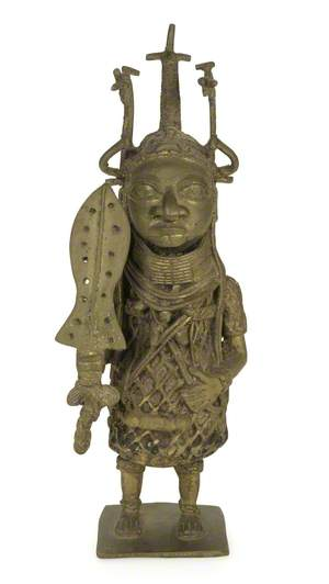 Figure with Sword and Headdress