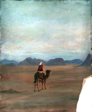 Camel Rider in Mountainous Desert