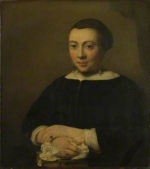 Portrait of a Young Woman with her Hands Folded on a Book