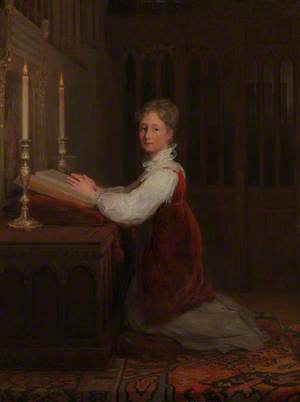 A Young Woman Kneeling at a Prayer Desk