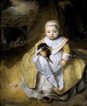A Child Holding a Dog