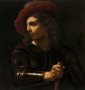 A Young Man in Armour Wearing a Red Cap and Holding a Staff