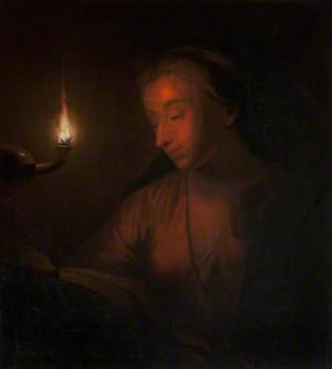 A Woman Reading by Lamplight
