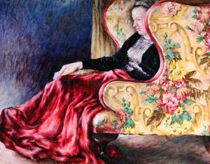 Woman Seated in a Floral Armchair