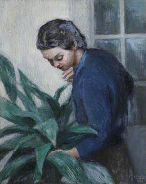 Lady in a Blue Shirt Tending a Plant