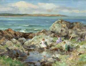 Three Girls by a Rock Pool