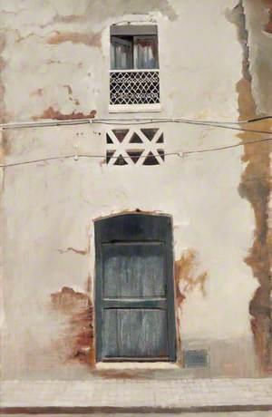 Spanish Facade with Blue Door