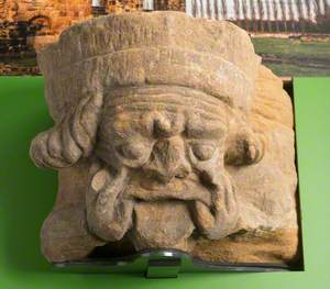 Sandstone Corbel Carved with Human Head with Fingers in the Corners of Mouth: Monk Bretton Priory
