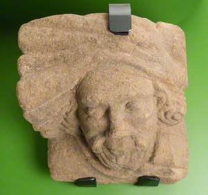 Sandstone Corbel with Realistic Male Human Head Wearing Hat or Turban: Monk Bretton Priory