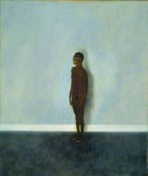 Model Standing against Blue Wall