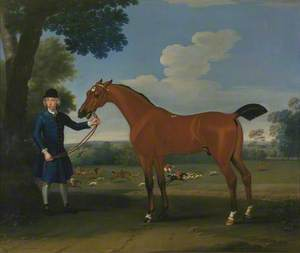 A Bay Hunter Held by a Groom, with a Stag-Hunt in the Background
