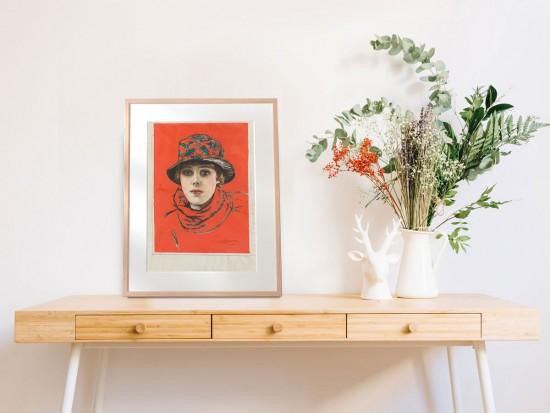A framed print of 'Girl in a Hat' by William Bruce Ellis Ranken (1881–1941)