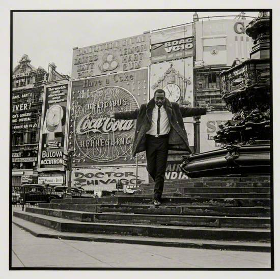 Mike Eghan at Picadilly Circus, London