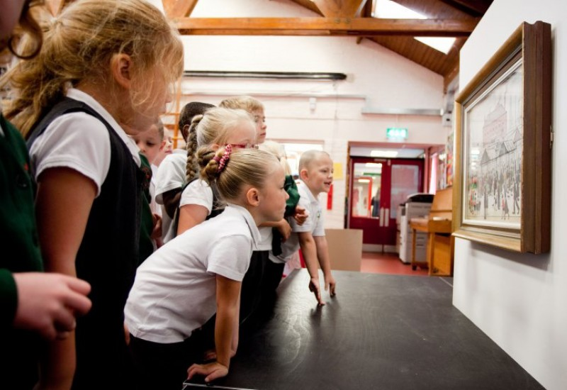 Pupils from St Matthew's Primary School in Stretford examining a work by L. S. Lowry during our Masterpieces in Schools project in 2013