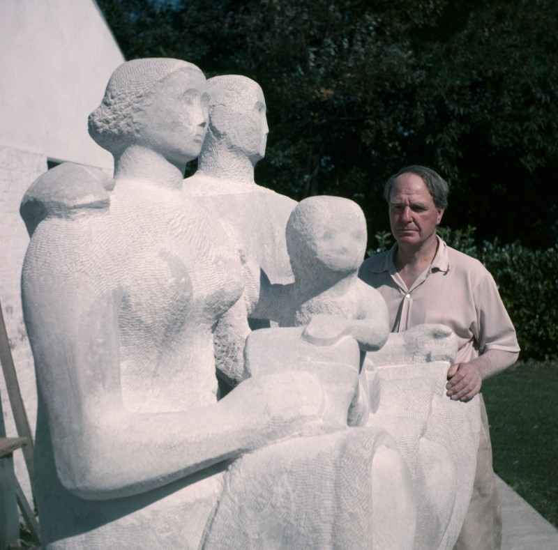 Henry Moore with 'Harlow Family Group' 1954–1955 (LH 364) outside the Top Studio, Perry Green