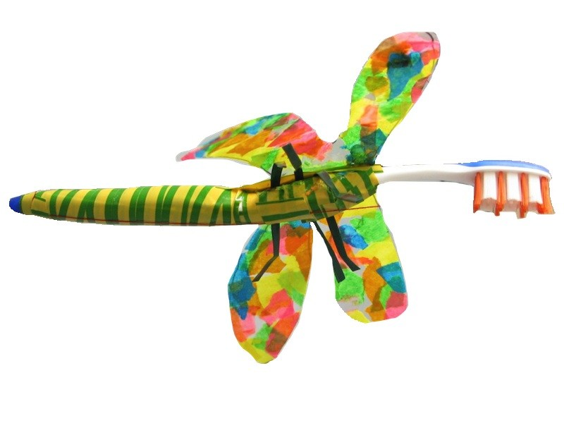 A toothbrush dragonfly inspired by 'Lobster Telephone'