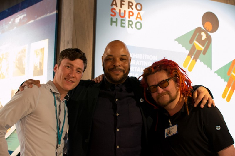 Adam, Jon Daniel and Yazz Vanducci, in front of Jon's 'Afro Supa Hero' exhibition