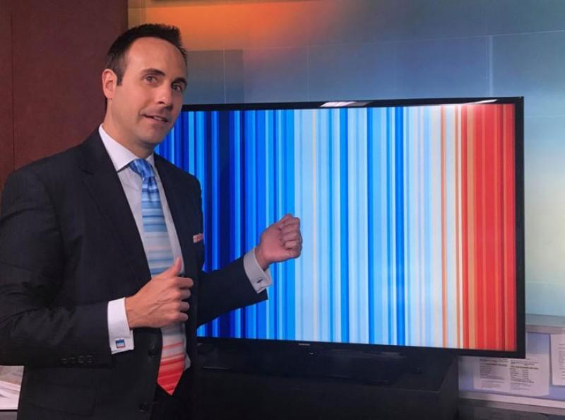 Jeff Berardelli wearing the warming-stripes graphic