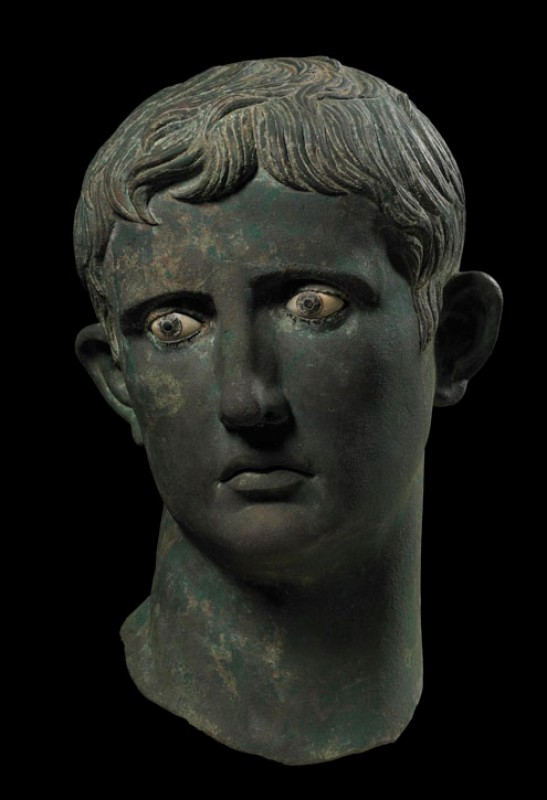 c.27–25 BC, bronze, eyes inlaid with glass pupils and irises of calcite, probably made in Egypt. The head was once part of a larger than life-size statue