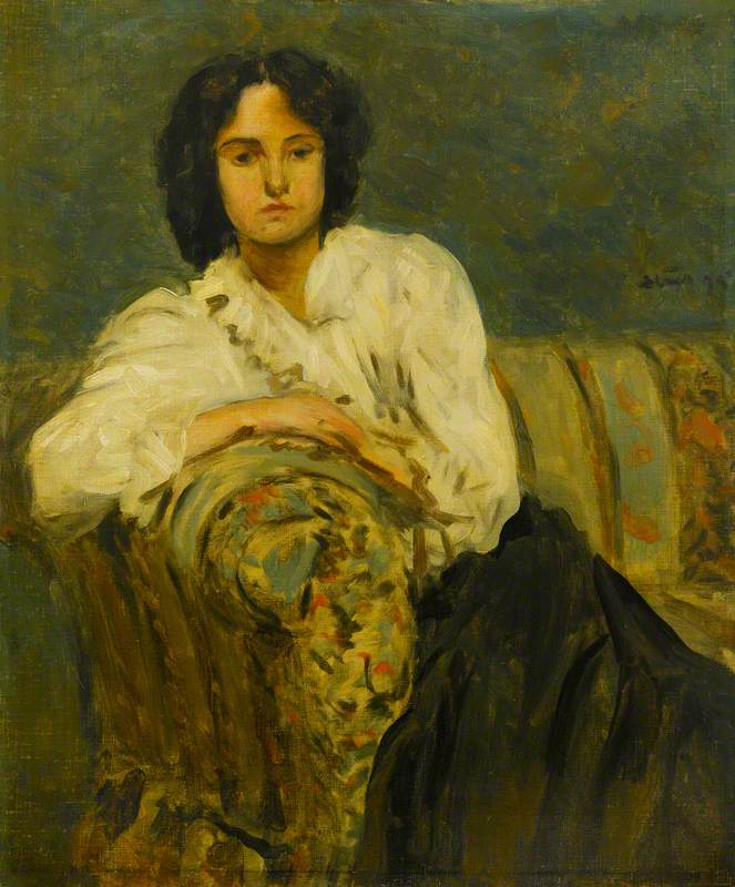 Girl in a White Blouse on a Sofa