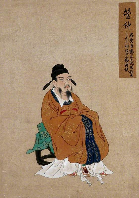 A Seated Chinese Figure with Grey Beard and Black Hat