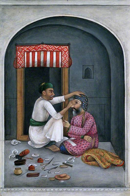 An Eye Surgeon Operating on a Man