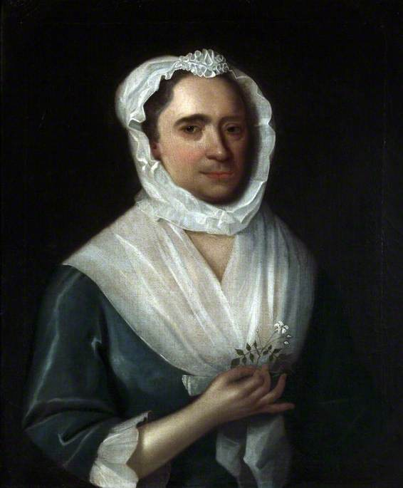 Portrait of a Woman Wearing a Blue Silk Dress Holding a Jasmine Flower