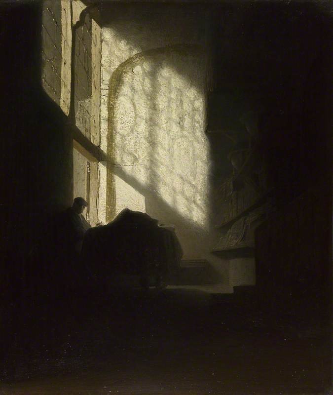 A Man seated reading at a Table in a Lofty Room